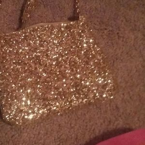 A purse that is gold from Old Navy